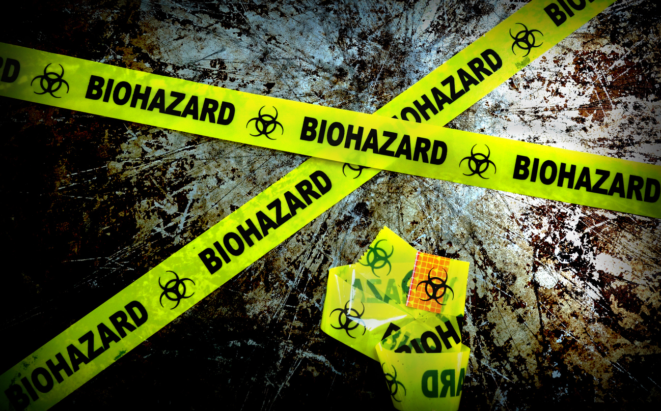 yellow biohazard tape on grunge background